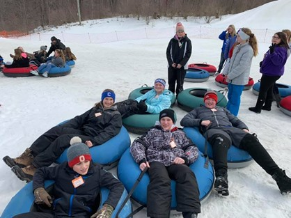 students snow tubing